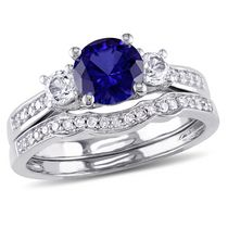 Tangelo 1.33 Carat T.G.W Created Blue and White Sapphire with 0.14 Carat T.W Diamond 10 K White Gold Three Stone Bridal Set 8.5