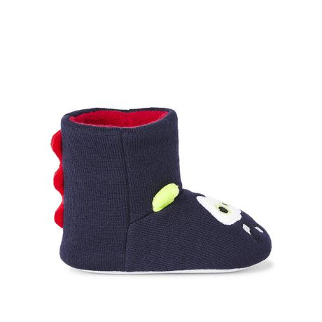 Fuzzy blue and green monster-themed slippers