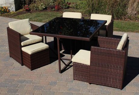 Henryka 9 piece dining patio set with cushions brown for Set de table en osier