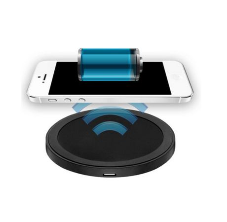 Black circular wireless charging station with white smartphone above it