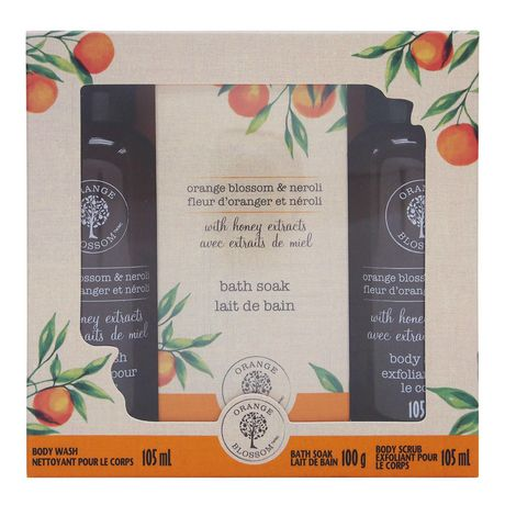 Grey box with decorations of oranges from Orange Blossom containing body wash, body scrub and bath soak