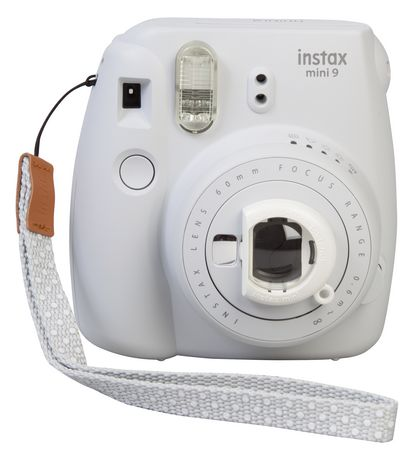 White Instax Mini 9 instant camera with built-in lens cover and white carrying cord