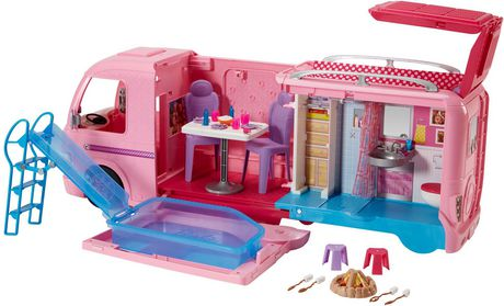 Pink plastic Barbie-themed RV camping play set with camping accessories