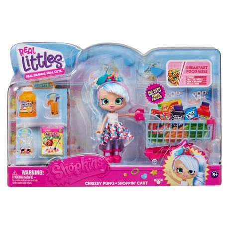 Plastic package from Shopkins containing toy girl, toy shopping cart and toy grocery accessories