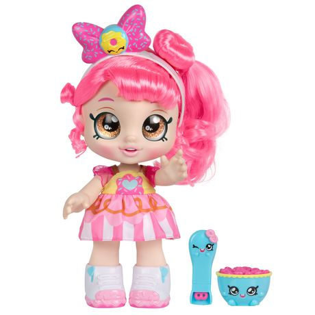 Doe-eyed toy doll girl with pink hair and clothes and plastic toy food, made by Kindi Kids