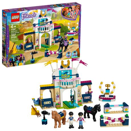 Boxed LEGO set with 337 pieces and built-up display of Stephanie's Horse Jumping in front