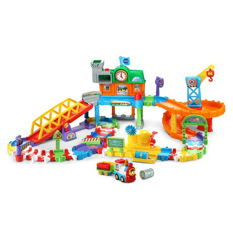 Multi-coloured plastic train set from VTech with train toys and accessories