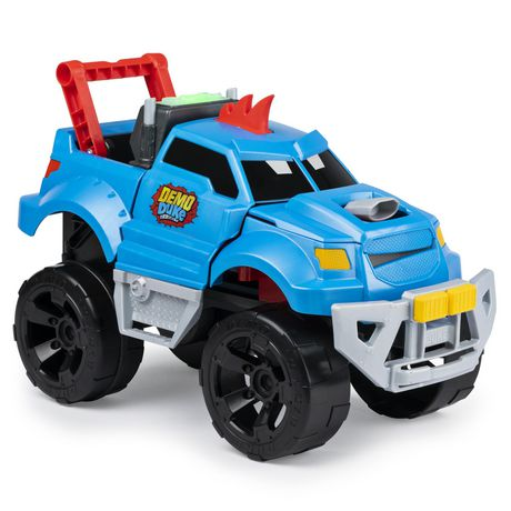Plastic blue Demo Duke truck with giant black wheels