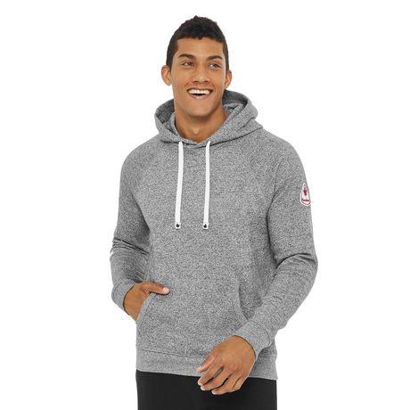 Smiling guy with short dark hair wearing a grey Canadiana men's raglan hoodie
