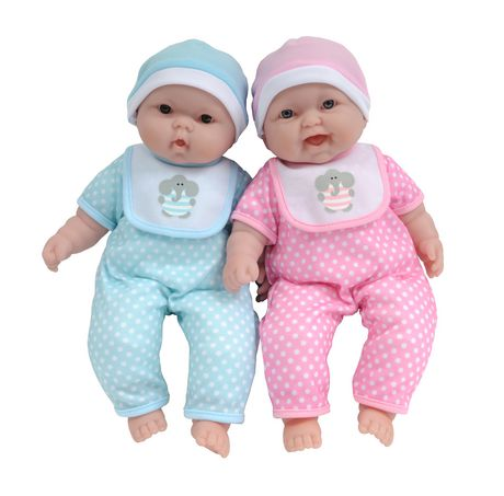 Two baby dolls from Baby Boutique wearing matching pink and green outfits