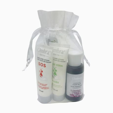 Gift bag from Ombra containing bath foam and hand lotions in a see-through grey holiday bag