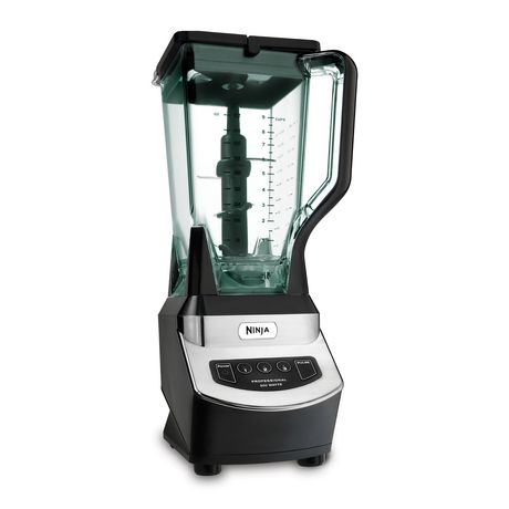 Silver and black blender from Ninja with sliced fruits on the left and ice on the right