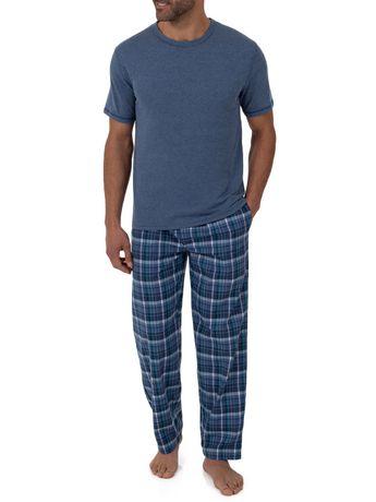 Man wearing dark blue t-shirt and blue plaid pajama pants