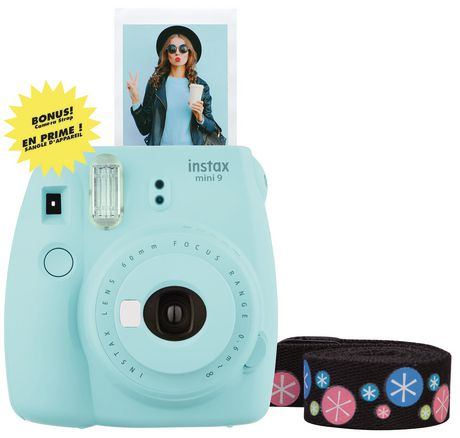 Light blue Instax Mini 9 instant camera with photo printing out of it and spooled decorative strap beside it, made by Fujifilm
