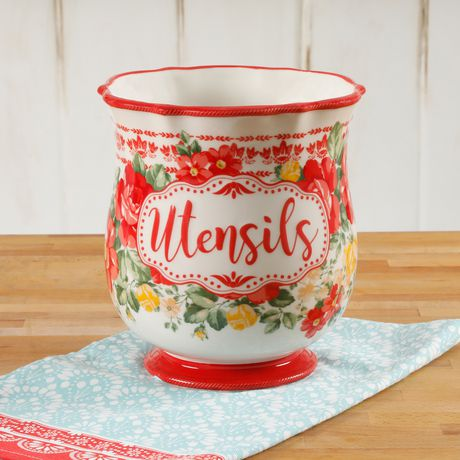 White utensils holder with floral motif and the word utensils on the front, made by Pioneer Woman