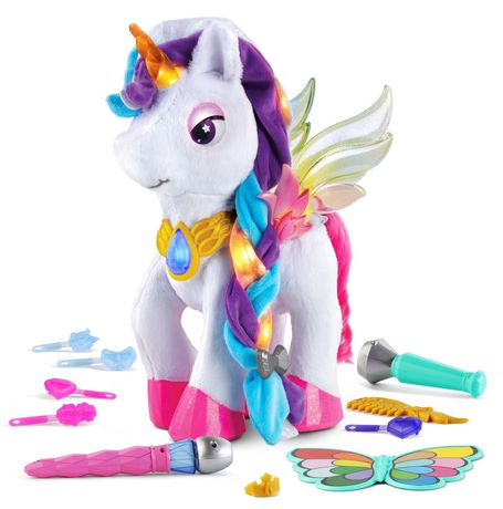 White stuffed unicorn with rainbow braided hair made by VTech with toy microphones and other accessories