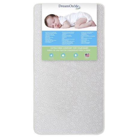 Best Waterproof or Stain-Resistant Mattress - Alternate Pick - Dream On Me orthopedic firm foam standard crib mattress with label tag showing a sleeping baby