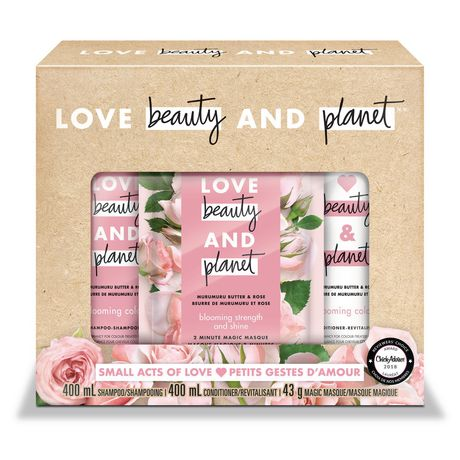 Beige gift pack from Love Beauty and Planet with plastic window showing hair care products inside