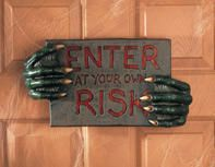 Signe 'Enter At Your Own Risk'
