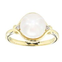 10 Karat yellow gold 9MM Cultured Freshwater Button pearl and diamond ring.