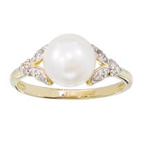10 Karat yellow gold 8MM Cultured Freshwater Button pearl and diamond ring.